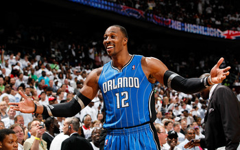 ATLANTA, GA - APRIL 22:  Dwight Howard #12 of the Orlando Magic reacts after being called for a technical foul against the Atlanta Hawks during Game Three of the Eastern Conference Quarterfinals in the 2011 NBA Playoffs at Philips Arena on April 22, 2011