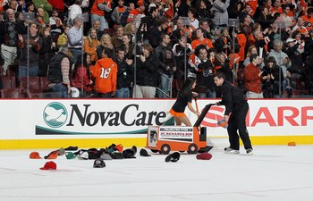 PHILADELPHIA, PA - MARCH 12:  Hats are removed from the ice after a hat trick by Ville Leino (not pictured)  of the Philadelphia Flyers against the Atlanta Thrashers on March 12, 2011 at Wells Fargo Center in Philadelphia, Pennsylvania. The Thrashers defe