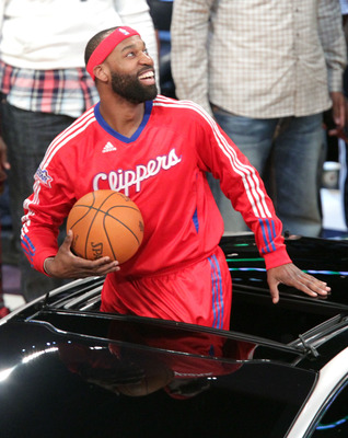 LOS ANGELES, CA - FEBRUARY 19:  NBA player Baron Davis of the L.A. Clippers passes the ball from inside the car to teammate, Blake Griffin, and he attempts a slam dunk, during the Sprite Slam Dunk Contest apart of NBA All-Star Saturday Night at Staples Ce