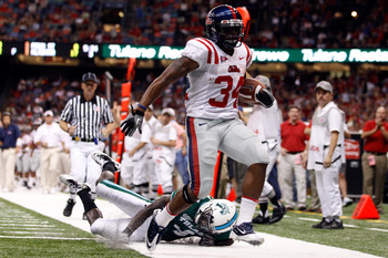 NEW ORLEANS - SEPTEMBER 11:  Brandon Bolden #34 of the Ole Miss Rebels scores a touchdown over Shakiel Smith #4 of the Tulane Green Wave at the Louisiana Superdome on September 11, 2010 in New Orleans, Louisiana.  (Photo by Chris Graythen/Getty Images)