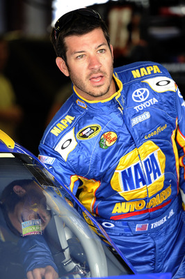 TALLADEGA, AL - APRIL 15:  Martin Truex Jr., driver of the #56 NAPA Auto Parts Toyota, stands in the garage during practice for the NASCAR Sprint Cup Series Aaron's 499 at Talladega Superspeedway on April 15, 2011 in Talladega, Alabama.  (Photo by John Ha