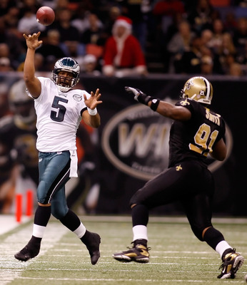 NEW ORLEANS - DECEMBER 23:  Donovan McNabb #5 of the Philadelphia Eagles throws a pass over Will Smnith #91 of the New Orleans Saints on December 23, 2007 at the Louisiana Superdome in New Orleans, Louisiana.  (Photo by Chris Graythen/Getty Images)