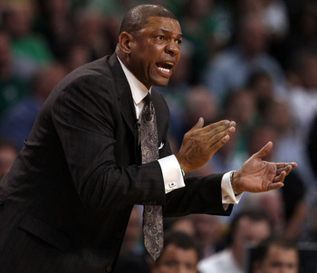 BOSTON, MA - MAY 09:  Head coach Doc Rivers of the Boston Celtics encourages his players in overtime against the Miami Heat in Game Four of the Eastern Conference Semifinals in the 2011 NBA Playoffs on May 9, 2011 at the TD Garden in Boston, Massachusetts