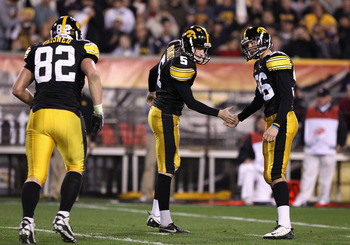 TEMPE, AZ - DECEMBER 28:  Kicker Michael Meyer #96 of the Iowa Hawkeyes high fives teammate Ryan Donahue #5 after kicking a 21 yard field goal against the Missouri Tigers during the third quarter of the Insight Bowl at Sun Devil Stadium on December 28, 20