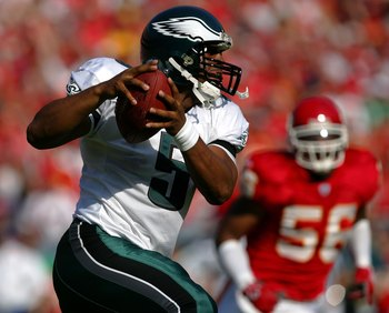 KANSAS CITY, MO - OCTOBER 02:  Quarterback Donovan McNabb #5 of the Philadelphia Eagles is chased by Derrick Johnson #56 of the Kansas City Chiefs during the first half of the game on October 2, 2005 at Arrowhead Stadium in Kansas City, Missouri.  (Photo