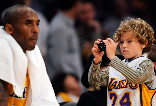 LOS ANGELES, CA - APRIL 9:  KDuke Keaton, 8, son of actress Diane Keaton takes picture of Kobe Bryant #24 of the Los Angeles Lakers during a break in the action against the Denver Nuggets at Staples Center April 9, 2009 in Los Angeles, California.  NOTE T