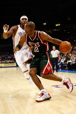 OKLAHOMA CITY - OCTOBER 29:  Michael Redd #22 of the Milwaukee Bucks drives to the basket past Chris Wilcox #54 of the Oklahoma City Thunder at the Ford Center on October 29, 2008 in Oklahoma City, Oklahoma. The Bucks won 98-87.  NOTE TO USER: User expres
