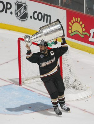 ANAHEIM, CA - JUNE 06:  Scott Niedermayer #27 of the Anaheim Ducks hoists the Stanley Cup after his team's victory over the Ottawa Senators during Game Five on June 6, 2007 at Honda Center in Anaheim, California. The Ducks defeated the Senators 6-2 to win