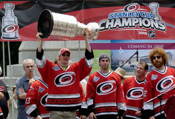 RALEIGH, NC - JUNE 21:  Eric Staal hoists the Stanley Cup overhead from the podium during a 'Hail To Our Champions' parade for the Carolina Hurricanes on June 21, 2006 to celebrate the team's Stanley Cup finals victory over the Edmonton Oilers in Raleigh,