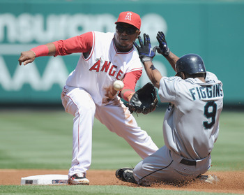 ANAHEIM, CA - SEPTEMBER 12:  Erick Aybar #2 of the Los Angeles Angels of Anaheim takes a throw at second base as Chone Figgins #9 of the Seattle Mariners is caught stealing during the first inning at Angel Stadium on September 12, 2010 in Anaheim, Califor
