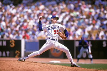 LOS ANGELES - 1989:  Orel Hershiser #55 of the Los Angeles Dodgers pitches against the Chicago Cubs in the 1989 season at Dodger Stadium in Los Angeles, California. (Photo by Mike Powell/Getty Images)
