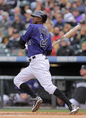 DENVER, CO - MAY 01:  Center fielder Dexter Fowler #24 of the Colorado Rockies takes an at bat against the Pittsburgh Pirates at Coors Field on May 1, 2011 in Denver, Colorado. The Pirates defeated the Rockies 8-4.  (Photo by Doug Pensinger/Getty Images)