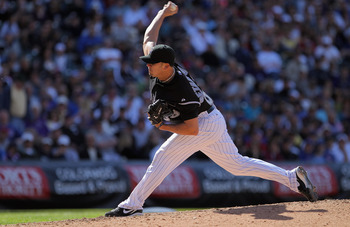 DENVER, CO - APRIL 17:  Pitcher Rafael Betancourt #63 of the Colorado Rockies works in relief against the Chicago Cubs at Coors Field on April 17, 2011 in Denver, Colorado. Betancourt pitched 2/3rds of the eighth inning and earned the win as the Rockies d
