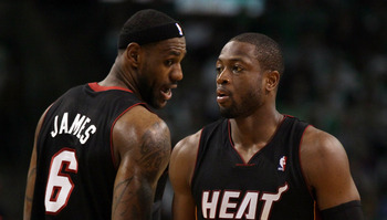 BOSTON, MA - MAY 09: LeBron James #6 talks with teamamte Dwyane Wade #3 of the Miami Heat in Game Four of the Eastern Conference Semifinals in the 2011 NBA Playoffs on May 9, 2011 at the TD Garden in Boston, Massachusetts.  The Miami Heat defeated the Bos