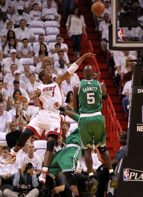 MIAMI, FL - MAY 03:  Chris Bosh #1 of the Miami Heat takes a shot over Kevin Garnett #5 and Jermaine Oneal #7 of the Boston Celticsduring Game Two of the Eastern Conference Semifinals of the 2011 NBA Playoffs at American Airlines Arena on May 3, 2011 in M