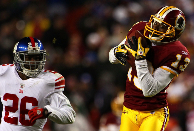 LANDOVER, MD - JANUARY 02:  Wide receiver Anthony Armstrong #13 of the Washington Redskins catches a touchdown pass over Antrel Rolle #26 of the New York Giants during the game at FedEx Field on January 2, 2011 in Landover, Maryland. The Giants won the ga