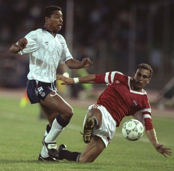 21 Jun 1990:  Des Walker (left) of England is robbed of the ball by Ibrahim Hassan (right) of Egypt during the World Cup match in Cagliari, Italy. England won the match 1-0. \ Mandatory Credit: David  Cannon/Allsport