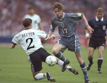 26 Jun 1996:  Steve McManaman of England (number 17) goes round Stefan Reuter of Germany during the European soccer championships semi final match between England and Germany at Wembley Stadium, London. Germany won the match after extra time in a penaltys