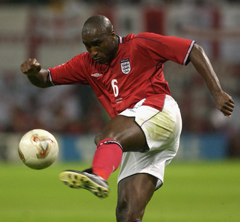 SAPPORO - JUNE 7:  Sol Campbell of England clears the ball from danger during the FIFA World Cup Finals 2002 Group F match between England and Argentina played at the Sapporo Dome, in Sapporo, Japan on June 7, 2002. England won the match 1-0. DIGITAL IMAG