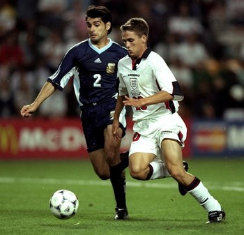 30 Jun 1998:  Michael Owen of England in action against Roberto Ayala of Argentina during the 1998 World Cup match against Argentina played in St Etienne, France.  The match finished in a 2-2 draw after extra-time and in a dramatic twist England once agai