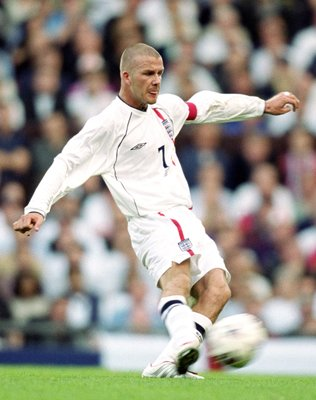 6 Oct 2001:  David Beckham of England scores an injury time equalising goal during the World Cup Group 9 Qualifier between England and Greece at Old Trafford in Manchester, England. England sealed qualification after the game ended 2-2.   \ Mandatory Cred