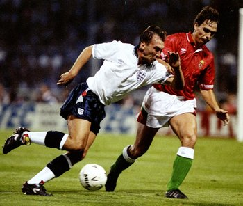 12 Sep 1990:  David Platt (left) of England is shadowed by Jozsef Keller of Hungary during a Friendly match at Wembley Stadium in London. England won the match 1-0. \ Mandatory Credit: Dan  Smith/Allsport