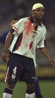 11 Oct 1997:  Paul Ince of England sports a bandage and blood stained shirt during the World Cup Qualifier against Italy at the Olympic Stadium in Rome, Italy. The game ended 0-0 and England qualified for the World Cup finals.  \ Mandatory Credit: Shaun B