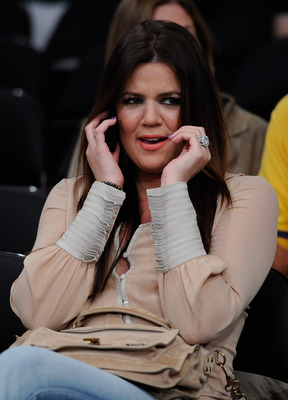 LOS ANGELES, CA - MAY 04:  TV personality Khloe Kardashian talks on the phone before Game Two of the Western Conference Semifinals in the 2011 NBA Playoffs between the Los Angeles Lakers and the Dallas Mavericks at Staples Center on May 4, 2011 in Los Ang