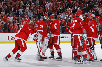 DETROIT - MAY 10: Jimmy Howard #35 of the Detroit Red Wings celebrates a 3-1 victory with teammates over the San Jose Sharks in Game Six of the Western Conference Semifinals during the 2011 NHL Stanley Cup Playoffs on May 10, 2011 at Joe Louis Arena in De
