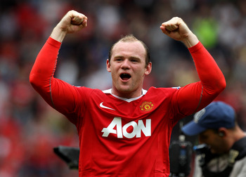 MANCHESTER, ENGLAND - MAY 08:  Wayne Rooney of Manchester United celebrates at the end of the Barclays Premier League match between Manchester United and Chelsea at Old Trafford on May 8, 2011 in Manchester, England.  (Photo by Alex Livesey/Getty Images)