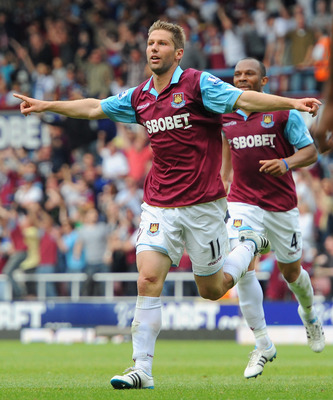 LONDON, ENGLAND - MAY 07:  Thomas Hitzlsperger of West Ham United celebrates scoring the equalising goal during the Barclays Premier League match between West Ham United and Blackburn Rovers at the Boleyn Ground on May 7, 2011 in London, England.  (Photo