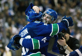 VANCOUVER, CANADA - APRIL 26: Alexandre Burrows #14 (right) of the Vancouver Canucks celebrates with Henrik Sedin #33 of the Vancouver Canucks after scoring the game winning goal against the Chicago Blackhawks during the overtime period in Game Seven of t