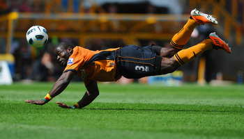 WOLVERHAMPTON, ENGLAND - MAY 08: George Elokobi of Wolves in action during the Barclays Premier League match between Wolverhampton Wanderers and West Bromwich Albion at Molineux on May 8, 2011 in Wolverhampton, England.  (Photo by Michael Regan/Getty Imag