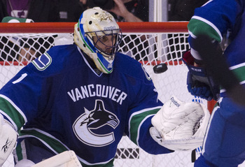 VANCOUVER, CANADA - APRIL 26: Goalie Roberto Luongo #1 of the Vancouver Canucks catches the puck after amking a save against the Chicago Blackhawks during the third period in Game Seven of the Western Conference Quarterfinals during the 2011 NHL Stanley C