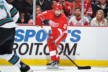 DETROIT - MAY 4: Pavel Datsyuk #13 of the Detroit Red Wings skates with the puck against the San Jose Sharks in Game Three of the Western Conference Semifinals during the 2011 NHL Stanley Cup Playoffs on May 4, 2011 at Joe Louis Arena in Detroit, Michigan