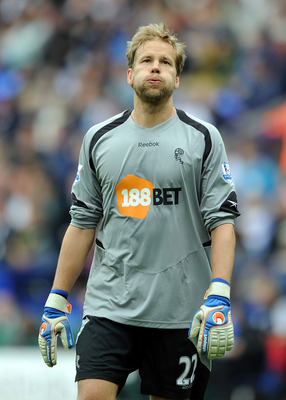 BOLTON, ENGLAND - MAY 07: Jussi Jaaskelainen of Bolton Wanderers reacts during the Barclays Premier League match between Bolton Wanderers and Sunderland at Reebok Stadium on May 7, 2011 in Bolton, England.  (Photo by Chris Brunskill/Getty Images)