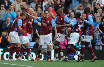 BIRMINGHAM, ENGLAND - MAY 07: Ashley Young of Aston Villa celebrates with team mates after scoring to make it 1-1 during the Barclays Premier League match between Aston Villa and Wigan Athletic on May 7, 2011 in Birmingham, England.  (Photo by Michael Reg