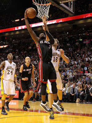 MIAMI, FL - MARCH 10:  Dwyane Wade #3 of the Miami Heat shoots over Pau Gasol #16 of  the Los Angeles Lakers  during a game at American Airlines Arena on March 10, 2011 in Miami, Florida. NOTE TO USER: User expressly acknowledges and agrees that, by downl