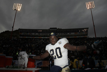 EL PASO, TX - DECEMBER 30:  Running back Cierre Wood #20 of the Notre Dame Fighting Irish celebrates a 33-17 win against the Miami Hurricanes at Sun Bowl on December 30, 2010 in El Paso, Texas.  (Photo by Ronald Martinez/Getty Images)