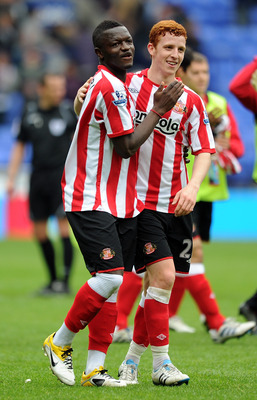 BOLTON, ENGLAND - MAY 07:  Sulley Muntari of Sunderland celebrates at full-time with team-mate Jack Colback (R) following the Barclays Premier League match between Bolton Wanderers and Sunderland at Reebok Stadium on May 7, 2011 in Bolton, England.  (Phot