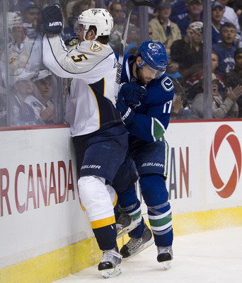 VANCOUVER, CANADA - MAY 7: Ryan Kesler #17 of the Vancouver Canucks checks Blake Geoffrion #5 of the Nashville Predators into the end boards during the third period in Game Five of the Western Conference Semifinals during the 2011 NHL Stanley Cup Playoffs
