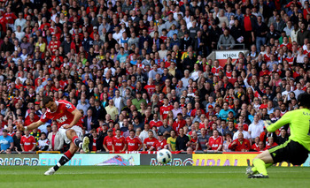 MANCHESTER, ENGLAND - MAY 08: Javier Hernandez of Manchester United scores the opening goal during the Barclays Premier League match between Manchester United and Chelsea at Old Trafford on May 8, 2011 in Manchester, England.  (Photo by Alex Livesey/Getty