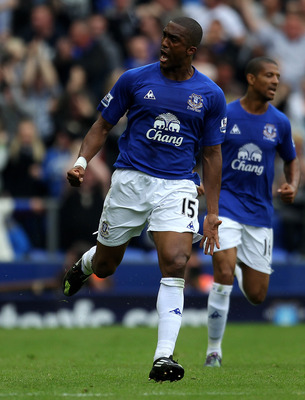 LIVERPOOL, ENGLAND - MAY 07:  Sylvain Distin (L) of Everton celebrates scoring his team's first goal during the Barclays Premier League match between Everton and Manchester City at Goodison Park on May 7, 2011 in Liverpool, England.  (Photo by Alex Livese