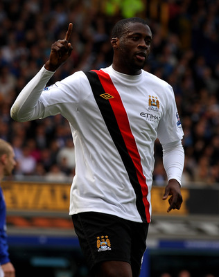 LIVERPOOL, ENGLAND - MAY 07:  Yaya Toure of Manchester City celebrates scoring the opening goal during the Barclays Premier League match between Everton and Manchester City at Goodison Park on May 7, 2011 in Liverpool, England. (Photo by Alex Livesey/Gett