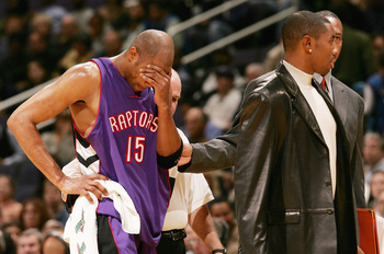 WAHINGTON DC - NOVEMBER 23:  Vince Carter #15 of the Toronoto Raptors leaves the court during the first half after he collided with Larry Hughes #20 of the Washington Wizards November 23, 2004 at the MCI Center in Washington D.C.  NOTE TO USER:  User expr