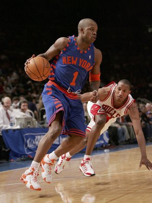 NEW YORK - MARCH 3:  Steve Francis #1 of the New York Knicks drives to the basket against Chris Duhon #21 of the Chicago Bulls on March 3, 2006 at Madison Square Garden in New York City. The Bulls defeated the Knicks 108-101.  NOTE TO USER: User expressly
