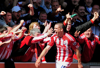 STOKE ON TRENT, ENGLAND - MAY 08:  Jonathan Walters of Stoke celebrates after scoring his team's third goal during the Barclays Premier League match between Stoke City and Arsenal at the Britannia Stadium on May 8, 2011 in Stoke on Trent, England.  (Photo