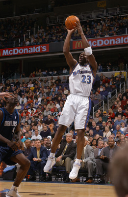 WASHINGTON - FEBRUARY 23:  Michael Jordan #23 of the Washington Wizards shoots against the Dallas Mavericks during the NBA game at MCI Center on February 23, 2003 in Washington, D.C.  The Mavericks won in overtime 106-101.  NOTE TO USER: User expressly ac