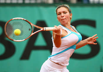 PARIS - JUNE 08:  Simona Halep of Romania hits a forehand during the Girl's Singles Final match against Elena Bogdan of Romania on day fifteen of the French Open at Roland Garros on June 8, 2008 in Paris, France.  (Photo by Julian Finney/Getty Images)