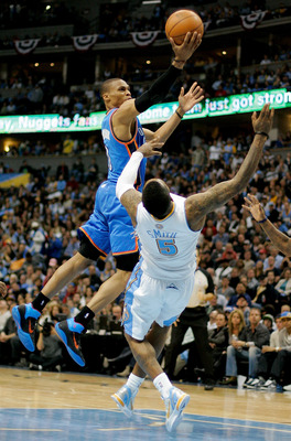 DENVER, CO - APRIL 25:  Russell Westbrook #0 of the Oklahoma City Thunder lays the ball up over a falling J.R. Smith #5 of the Denver Nuggets in Game Four of the Western Conference Quarterfinals in the 2011 NBA Playoffs at Pepsi Center on April 25, 2011 i